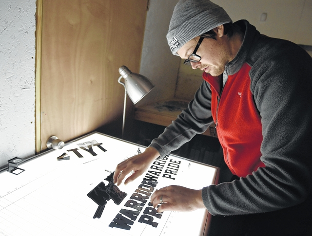John Krispin lines up films for a silk screen project at AxelRad in Wilkes-Barre. Aimee Dilger | Weekender