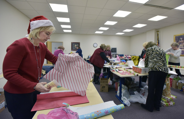 Volunteers are Santa's helpers for Home Instead's Be A Santa To A Senior