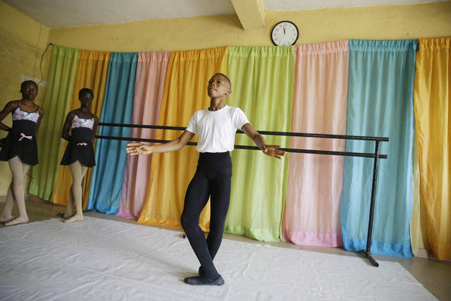 <p>Ballet dancer Anthony Mmesoma Madu rehearses in Lagos, Nigeria. Cellphone video showing the 11-year-old dancing barefoot in the rain went viral on social media. Madu's practice dance session was so impressive that it earned him a ballet scholarship with the American Ballet Theater in the U.S.</p>                                  <p>AP photo</p>
