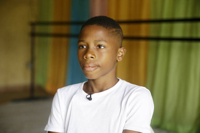 Ballet dancer Anthony Mmesoma Madu appears in his dance studio in Lagos, Nigeria on Aug. 18, 2020. Cellphone video showing the 11-year-old dancing barefoot in the rain went viral on social media. Madu's practice dance session was so impressive that it earned him a ballet scholarship with the American Ballet Theater in the U.S.