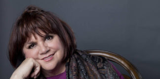 In this Sept. 17, 2013 file photo, American musician Linda Ronstadt poses in New York to promote the release of her memoir 'Simple Dreams.' Now at 74, the 10-time Grammy winner and Rock and Roll Hall of Famer has been recognized as a 'Legend' at the 33rd annual Hispanic Heritage Awards.