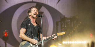 Eddie Vedder of Pearl Jam performs at Bonnaroo Music and Arts Festival in Manchester, Tenn. on June 11, 2016. Pearl Jam has encouraged fans to vote and asks them to take a pledge to try and mail-in their ballots. Vedder posted step-by-step photos on his Instagram page on how to vote by mail.                                  AP photo