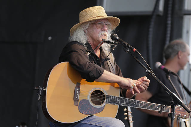In this Aug. 15, 2020 file photo Arlo Guthrie talks during a concert at a Woodstock 50th anniversary event in Bethel, N.Y .In lengthy posts on his Facebook page and website, the 73-year-old folksinger announced Friday, he is retiring from performance immediately. He's canceled numerous shows next year and says he won't book any new ones.                                  AP photo