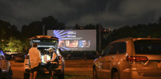 """FILE - Filmgoers attend the """"Nomadland"""" screening at the Queens Drive-In at the New York Hall of Science during the 58th New York Film Festival in New York on Sept. 26, 2020. After a historic season, winter is coming at the drive-in. Summer and early fall have seen the old drive-in transformed into a surprisingly elastic omnibus of pandemic-era gathering. Red-carpet premieres that would normally consume Lincoln Center uprooted to drive-ins. (Photo by Evan Agostini/Invision/AP, File)"""