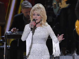 In this Nov. 13, 2019 file photo, Dolly Parton performs at the 53rd annual CMA Awards in Nashville, Tenn. Parton's $1 million gift to Nashville's Vanderbilt University helped researchers develop Moderna's experimental coronavirus vaccine, announced this week.                                  AP photo