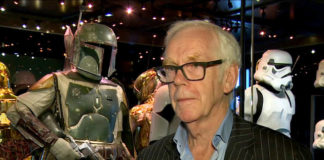 """Jeremy Bulloch speaks in front of the costume he wore while playing Boba Fett in 'Star Wars: Episode V – The Empire Strikes Back' and 'Star Wars: Episode VI – Return of the Jedi' at the Star Wars Identities exhibition in London on July 26, 2017. Bulloch, the English actor who played Boba Fett in the original """"Star Wars"""" trilogy, has died. His agents said in a statement that he died in a London hospital Thursday, Dec. 17, 2020, after years of suffering from Parkinson's disease. He was 75.                                  AP photo"""