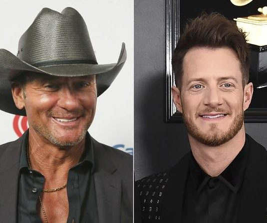 This combination photo shows Tim McGraw at the iHeartCountry Festival in Austin, Texas on May 4, 2019, left, and Tyler Hubbard of the duo Florida Georgia Line at the 61st annual Grammy Awards in Los Angeles on Feb. 10, 2019. Hubbard and McGraw are asking people to walk a mile in someone else's shoes in a call for unity on their new duet 'Undivided.' Hubbard wrote the song while isolating on his tour bus after testing positive for COVID-19 last year. He said the division in America in 2020 weighed heavily on his heart as he wrote the song. McGraw said the song isn't political, but makes a case for empathy instead of disagreement.                                  AP photo
