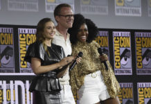 """Elizabeth Olsen, from left, Paul Bettany and Teyonah Parris participate in the """"WandaVision"""" portion of the Marvel Studios panel on day three of Comic-Con International on Saturday, July 20, 2019, in San Diego.                                  AP file photo"""