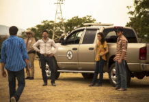 """This image released by IFC Films shows, from second left, George Lopez, Frank Grillo, Andie McDowell and Jake Allyn in a scene from """"No Man's Land.""""                                  IFC FIlms via AP"""